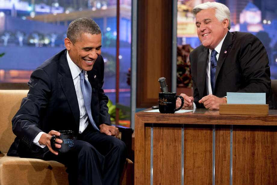 "President Barack Obama, left, smiles as he talks with Jay Leno during a commercial break during the taping of his appearance on ""The Tonight Show with Jay Leno"" in Los Angeles, Tuesday, Aug. 6, 2013. (AP Photo/Jacquelyn Martin) / AP"