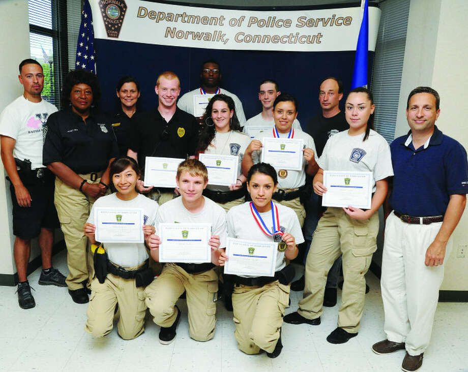 Kids who completed the program at the Connecticut Cadet Police Academy received a certifictate and some got got awards Monday at the Norwalk Police Heaquarters. Nellie Mann, Officer Christopher Holmes and State Senator Bob Duff were there to participate in the ceremony. Hour photo/Matthew Vinci