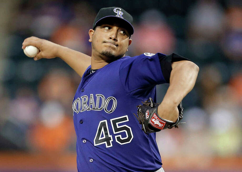 Colorado Rockies' Jhoulys Chacin delivers a pitch during the first inning of a baseball game against the New York Mets on Wednesday, Aug. 7, 2013, in New York. (AP Photo/Frank Franklin II) / AP