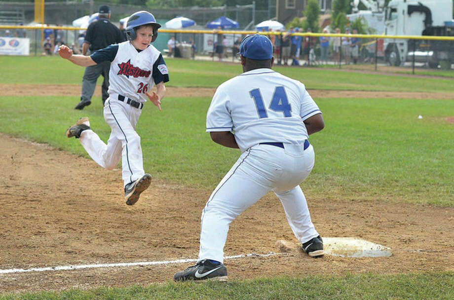 Hour Photo/Alex von KleydorffWestport's Drew Rogers, left, heads for third base as Newton's Matthew Beckles awaits a late throw during Wednesday's pool play finale at Breen Field in the New England Regional tournament in Bristol. Westport won the game, 10-4.