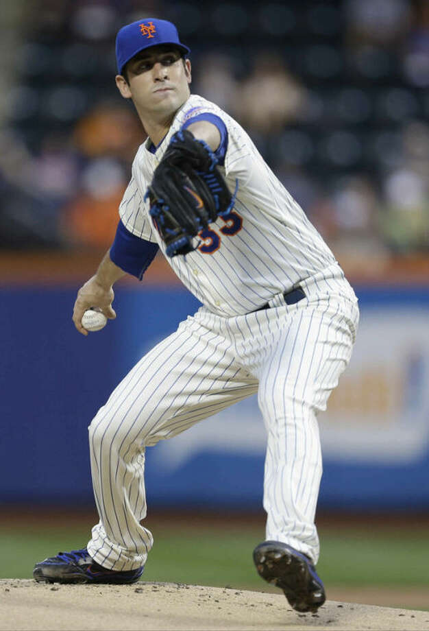 New York Mets pitcher Matt Harvey winds up during the first inning of a baseball game against the Colorado Rockies on Wednesday, Aug. 7, 2013, in New York.(AP Photo/Frank Franklin II)