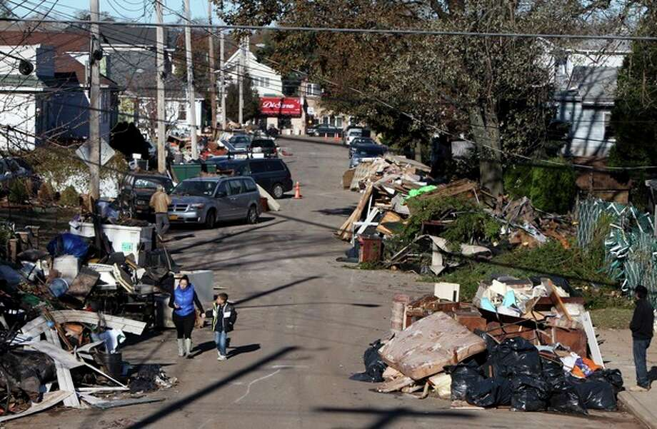 Garbage lies piled on the street in the New Dorp neighborhood of Staten Island, N.Y., Sunday, Nov. 4, 2012, in the aftermath of Superstorm Sandy. (AP Photo/Seth Wenig) / AP