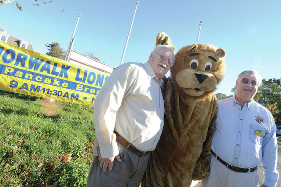 Hour photo / Matthew VinciChris Handrinos, general manager and CEO of the Norwalk Inn and Conference Center with Tom Stein, Lions Club past president, with Lion mascot Joe Daly welcome guests Sunday for the club's annual pancake breakfast. / (C)2011 {your name}, all rights reserved