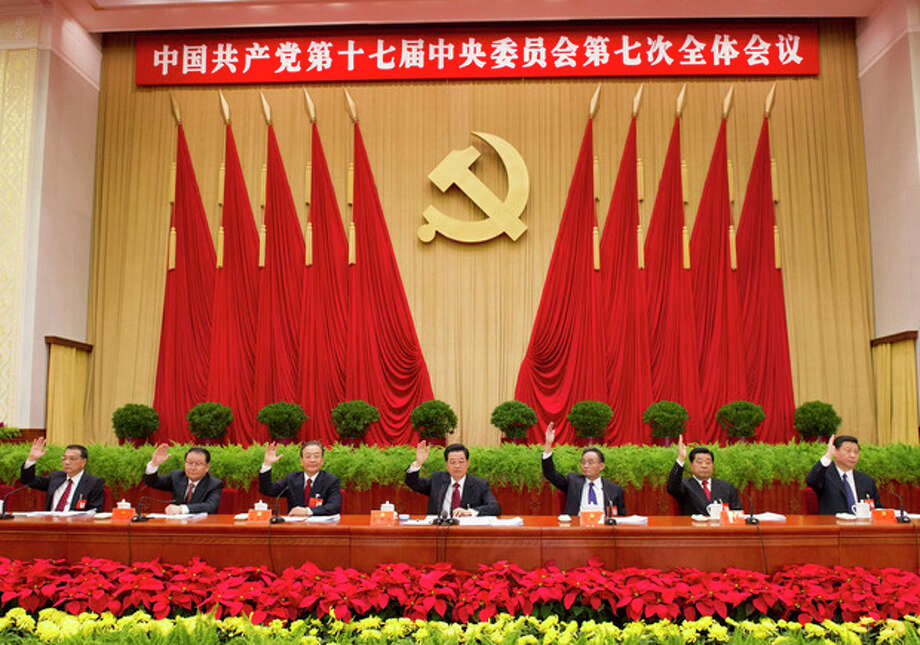 In this photo released by China's Xinhua News Agency, Chinese senior leaders Hu Jintao, center, Wu Bangguo, third right, Wen Jiabao, third left, Jia Qinglin, second right, Li Changchun, second left, Xi Jinping, right, Li Keqiang, left, attend the Seventh Plenary Session of the 17th Central Committee of the Communist Party of China (CPC) in Beijing, China, on Sunday, Nov. 4, 2012. The session was held from Nov. 1 to Nov. 4 in Beijing and presided over by the Political Bureau of the CPC Central Committee. (AP Photo/Xinhua, Li Xueren) NO SALES / Xinhua News Agency