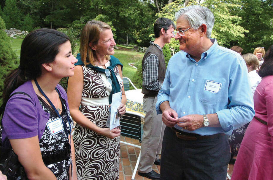 Dr Gary Richards, Wilton Superintendent of Schools, talks with Nicole Mok and Jo Gallagher at the new teacher reception in this file photo.