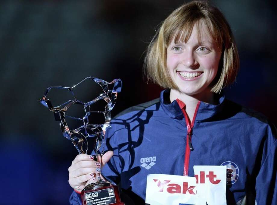 Katie Ledecky of the Unted States holds the FINA Best Female Swimmer of the event trophy at the FINA Swimming World Championships in Barcelona, Spain, Sunday, Aug. 4, 2013. (AP Photo/Manu Fernandez) / AP