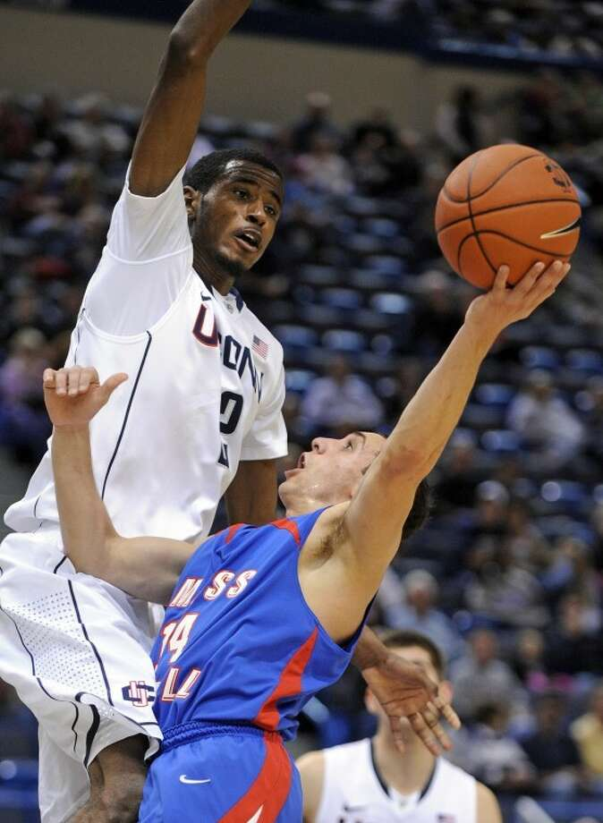 Massachusetts Lowell's Greg DeSantis, right, is guarded by Connecticut's Deandre Daniels during the first half of an exhibition NCAA college basketball game in Hartford, Conn., Sunday, Nov. 4, 2012. Connecticut won the game 100-62. (AP Photo/Fred Beckham)