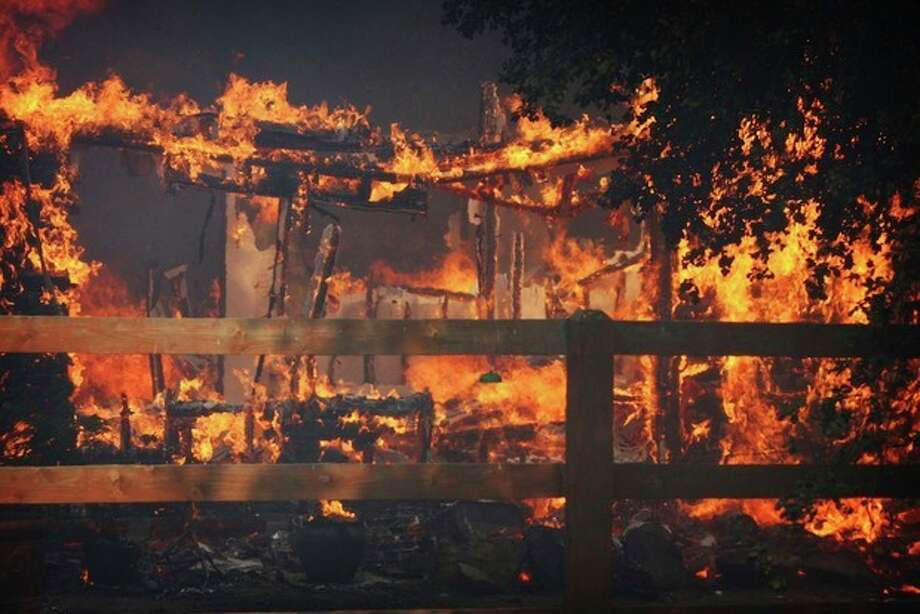 Multiple structures burn in the Poppet Flats area as the Silver Fire roared through the area along Hwy 243 between Banning and Idyllwild, Calif. on Wednesday, Aug. 7, 2013. (AP Photo/The Press-Enterprise, Frank Bellino) / The Press-Enterprise