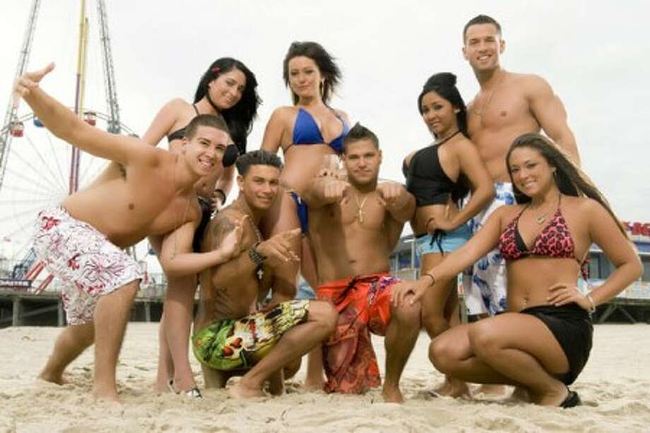 """The cast of """"Jersey Shore,"""" from left, Vinny Guadagnino, Angelina Pivarnick, Paul """" DJ Pauly D"""" Delvecchio, Jenni """"JWOWW"""" Farley, Ronnie Magro, Nicole """"Snooki"""" Polizzi, Mike """"The Situation"""" Sorrentino and Sammi """"Sweetheart"""" Giancola. (AP Photo/MTV, file)"""