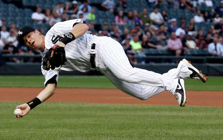Chicago White Sox second baseman Gordon Beckham fields a ground ball hit by New York Yankees' Brett Gardner but is unable to throw him out at first during the first inning of a baseball game on Wednesday, Aug. 7, 2013, in Chicago. (AP Photo/Charles Rex Arbogast) / AP