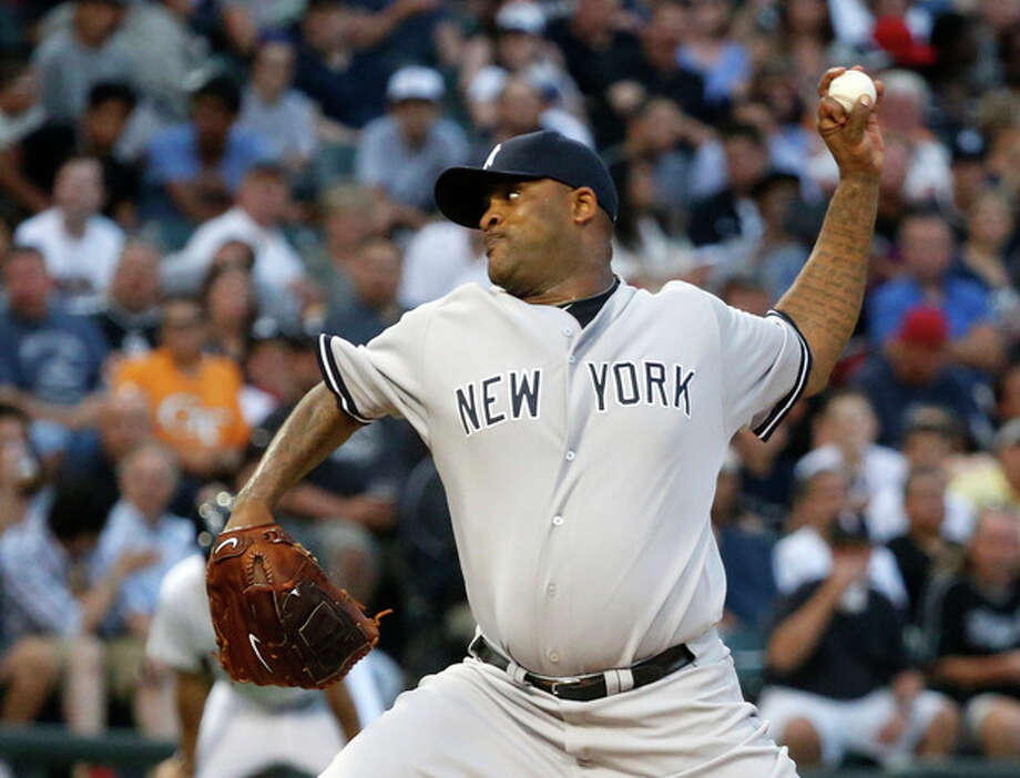 New York Yankees starting pitcher CC Sabathia delivers during the second inning of a baseball game against the Chicago White Sox, Wednesday, Aug. 7, 2013, in Chicago. (AP Photo/Charles Rex Arbogast) / AP