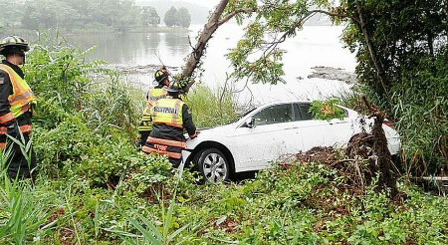Contributed photo A driver was able to free herself from the vehicle she was driving this morning before it sank into the Saugatuck River.