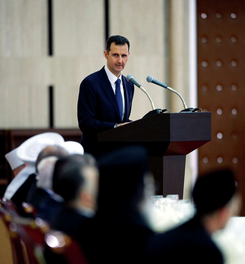 In this Sunday, Aug. 4, 2013 photo released by the Syrian official news agency SANA, Syrian President Bashar Assad delivers a speech at an Iftar dinner with political and religious figures in Damascus, Syria. (AP Photo/SANA) / SANA