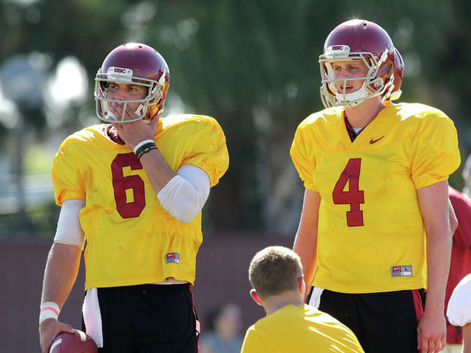 Southern California quarterback Cody Kessler, left, stands next to quarterback Max Browne during NCAA college football practice on Tuesday, Aug. 6, 2013, in Los Angeles. (AP Photo/Jae C. Hong) / AP