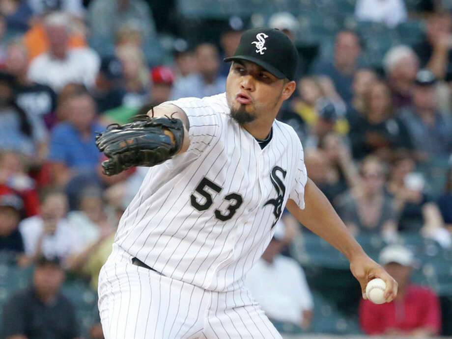 Chicago White Sox starting pitcher Hector Santiago delivers during the first inning of a baseball game against the New York Yankees, Wednesday, Aug. 7, 2013, in Chicago. (AP Photo/Charles Rex Arbogast) / AP