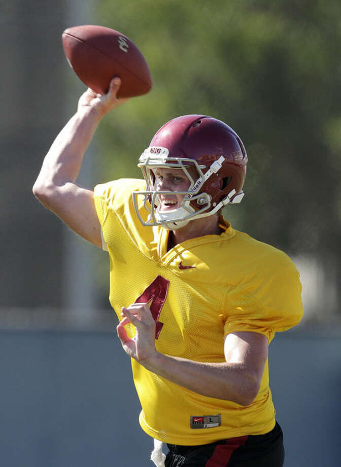 Southern California quarterback Max Browne throws the ball during NCAA college football practice on Tuesday, Aug. 6, 2013, in Los Angeles. (AP Photo/Jae C. Hong)