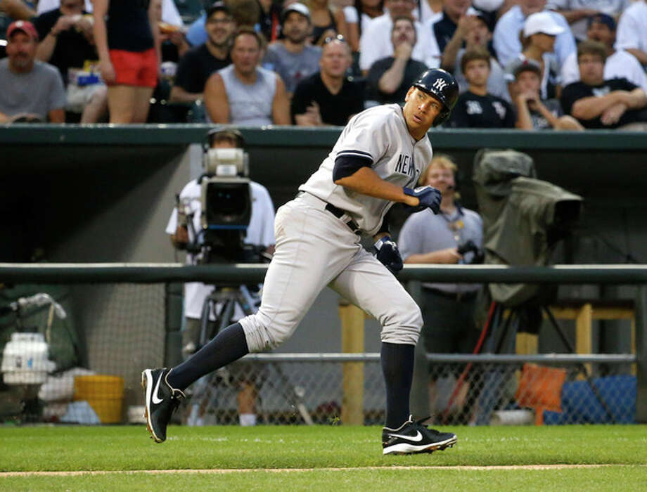 New York Yankees' Alex Rodriguez hustles back to third and is unable to score on Vernon Wells' bloop RBI-single off a pitch from Chicago White Sox's Hector Santiago during the third inning of a baseball game on Wednesday, Aug. 7, 2013, in Chicago. (AP Photo/Charles Rex Arbogast) / AP