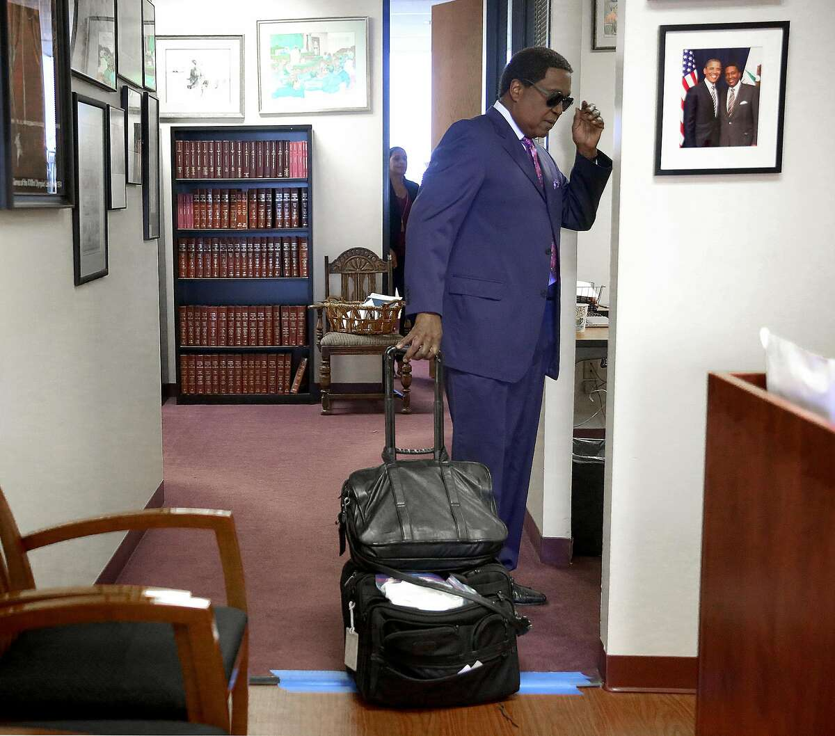 Civil rights attorney John Burris arrives at his office to get ready for a news conference on the OPD sex scandal on Wednesday, June 15, 2016 in Oakland, Calif.