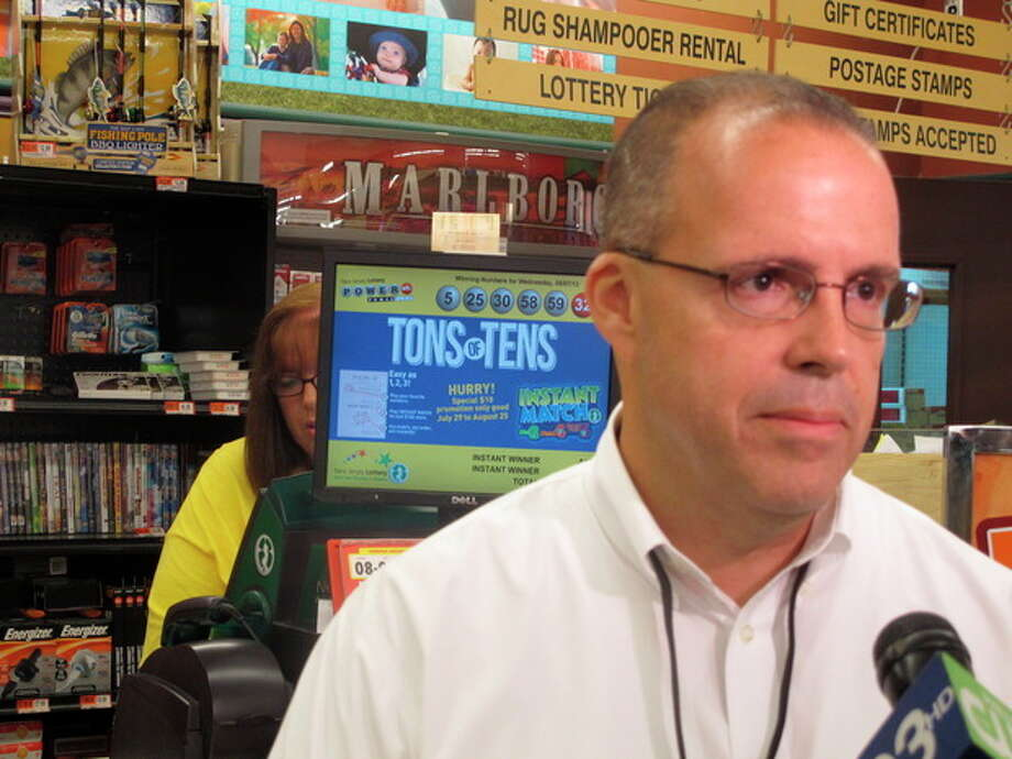 Phil Weber, director of the Acme Markets store in Little Egg Harbor, N.J, speaks with reporters on Thursday, Aug. 8, 2013. His store sold one of three winning tickets for Wednesday's Powerball drawing with a jackpot of $448 million. (AP Photo/Geoff Mulvihill) / AP