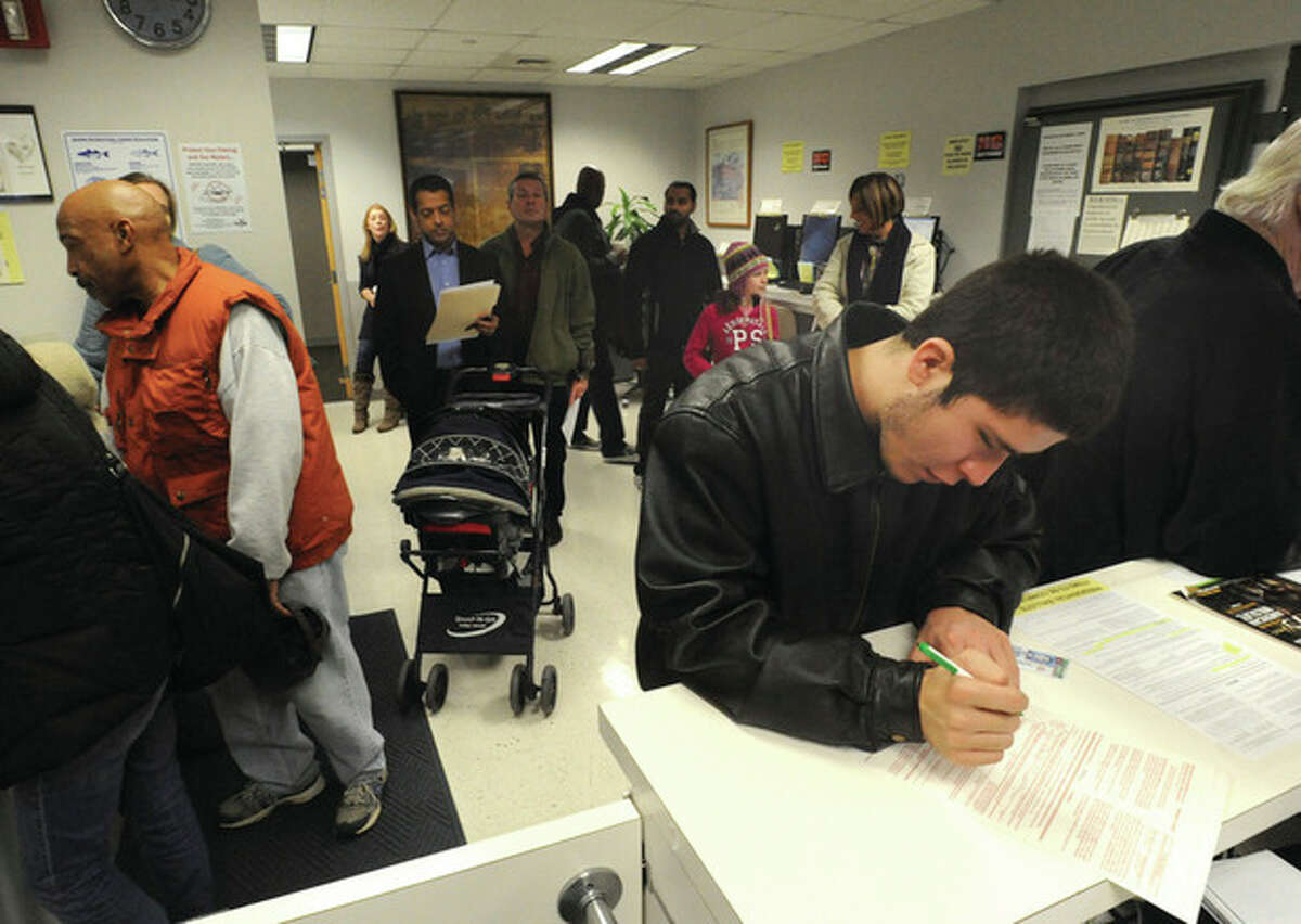 Hour photo / Matthew Vinci Norwalk residents who are not registered voters cast their ballots Monday for president and vice president at Norwalk City Hall's Town Clerk's office.