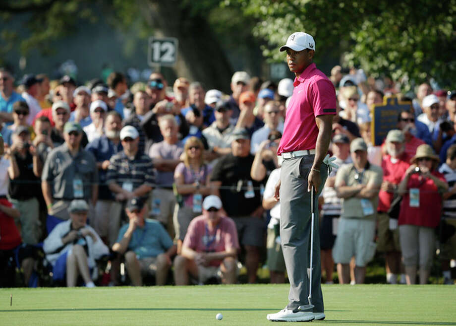 Tiger Woods looks over a putt on the sixth hole during a practice round for the PGA Championship golf tournament at Oak Hill Country Club, Wednesday, Aug. 7, 2013, in Pittsford, N.Y. (AP Photo/Charlie Riedel) / AP