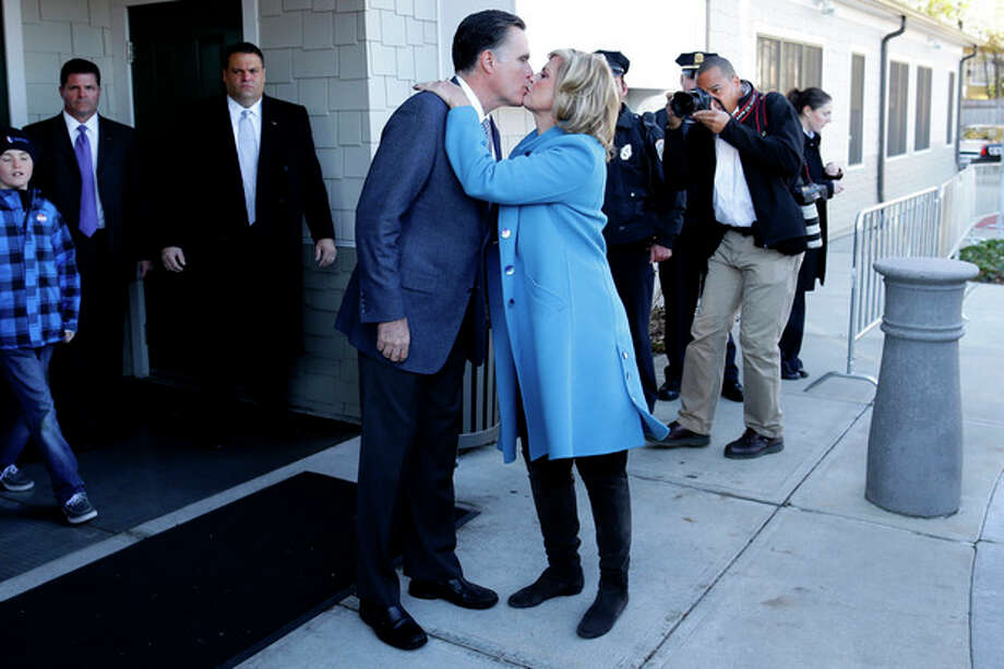 Republican presidential candidate, former Massachusetts Gov. Mitt Romney kisses wife Ann Romney after they voted in Belmont, Mass., Tuesday, Nov. 6, 2012.(AP Photo/Charles Dharapak) / AP