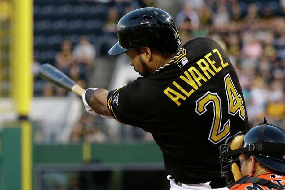 Pittsburgh Pirates' Pedro Alvarez hits an RBI triple off Miami Marlins starting pitcher Henderson Alvarez during the third inning of a baseball game in Pittsburgh Tuesday, Aug. 6, 2013. The Pirates' Andrew McCutchen scored from second on the hit. (AP Photo/Gene J. Puskar) / AP