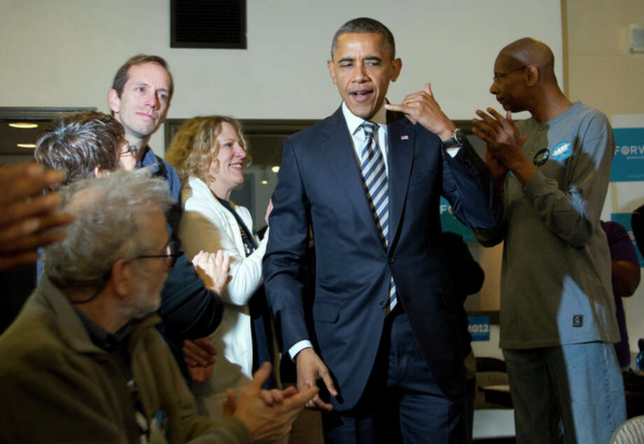 President Barack Obama gestures during a visit with volunteers in a call center at a campaign office the morning of the 2012 election, Tuesday, Nov. 6, 2012, in Chicago. (AP Photo/Carolyn Kaster) / AP