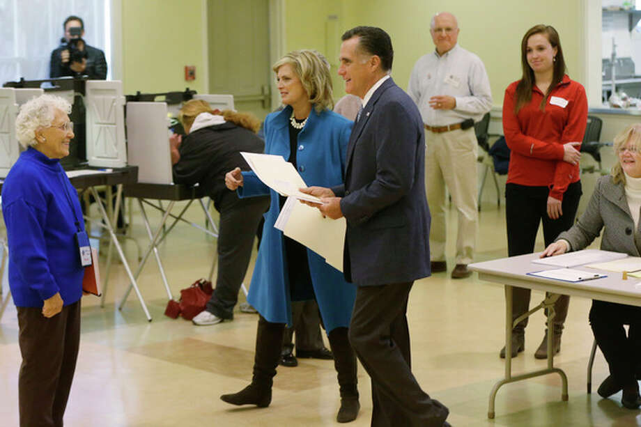 Republican presidential candidate, former Massachusetts Gov. Mitt Romney and wife Ann Romney arrive to vote in Belmont, Mass., Tuesday, Nov. 6, 2012.(AP Photo/Charles Dharapak) / AP