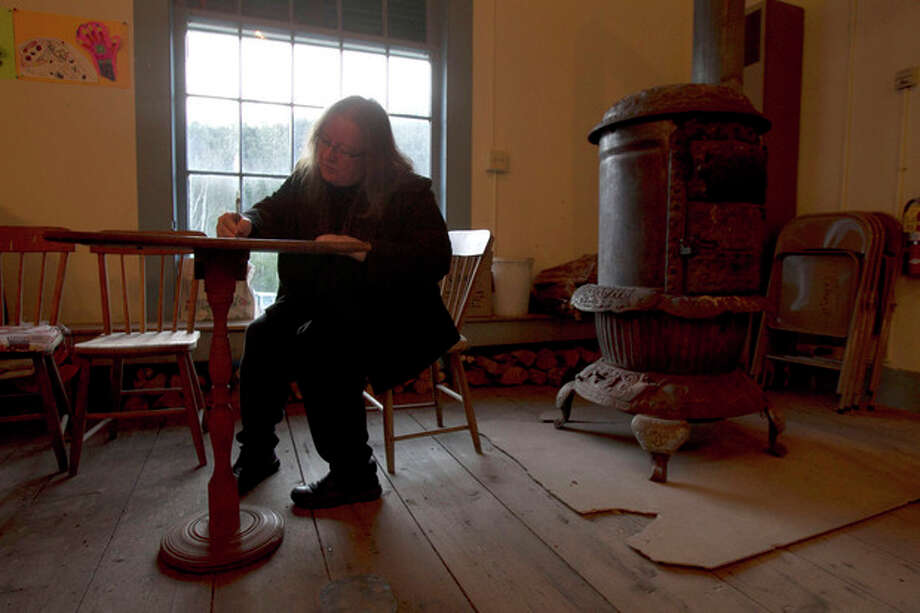 Nancy Tassey casts her ballot next to the wood stove on Election Day at the Town Hall, Tuesday, Nov. 6, 2012 in Calais, Vt. (AP Photo/Toby Talbot) / AP