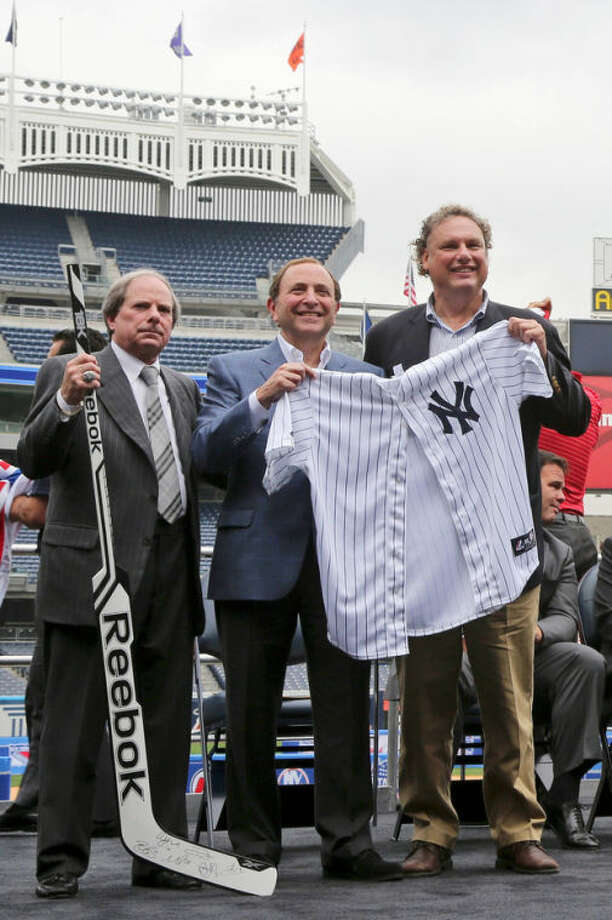New York Yankees chief operating officer Lonn Trost, left, NHL Commissioner Gary Bettman, center, and Yankees president Randy Levine pose for photographers during a news conference, Thursday, Aug. 8, 2013 at Yankee Stadium in New York. The stadium will host two outdoor, regular-season NHL games in January as part of the 2013-14 NHL season. (AP Photo/Mary Altaffer)