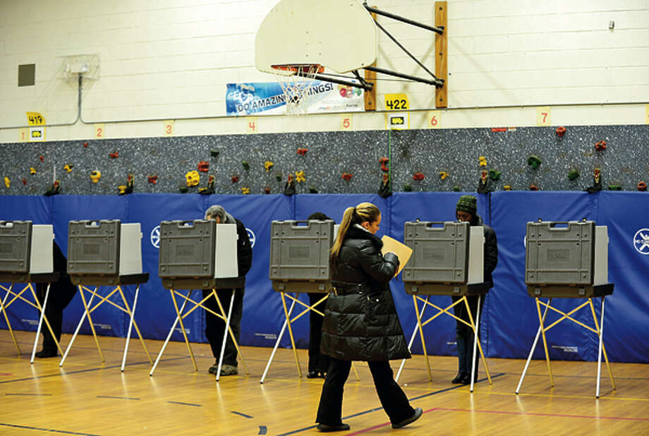 City residents cast their ballots at Marvin Elementary School for this years presidential election Tuesday. Hour photo / Erik Trautmann / (C)2012, The Hour Newspapers, all rights reserved