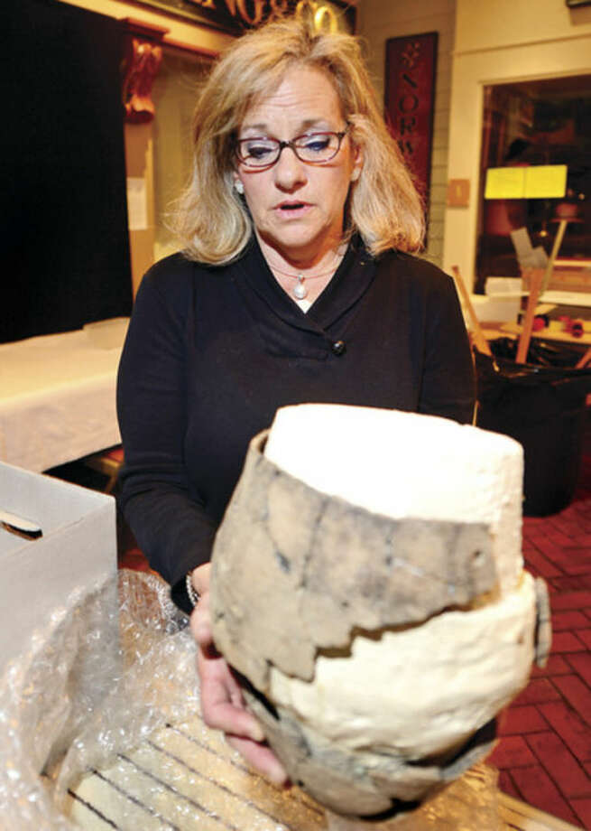 Norwalk Historical Commissioner, Holly Cuzzone, discusses plans for the buckets of pottery sherds, largely unidentifiable and perhaps hazardous, which The Norwalk Museum has collected over the yeras that pose special problem in disposing of them or relocating them to the new museum.Hour photo / Erik Trautmann