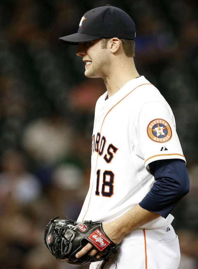 Houston Astros starting pitcher Jordan Lyles reacts after giving up a two-run homer to Boston Red Sox's Jacoby Ellsbury in the third inning of a baseball game Tuesday, Aug. 6, 2013, in Houston. (AP Photo/Pat Sullivan)