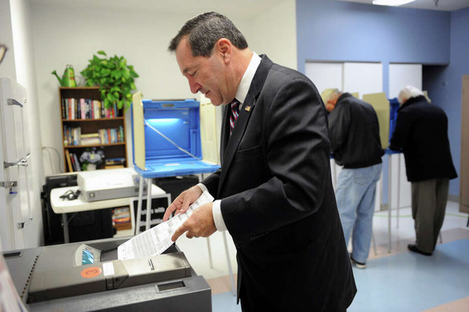 Joe Donnelly, Indiana Democratic candidate for U.S. Senate, casts his vote Tuesday Nov. 6, 2012 in South Bend, Ind. Donnelly is running for the Senate seat that was held by Republican Richard Lugar who lost in the primary to Richard Murdock. (AP Photo/Joe Raymond) / FR25092 AP