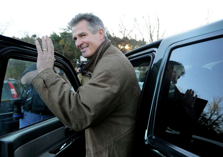 U.S. Sen. Scott Brown, R-Mass., gets into his truck after voting in Wrentham, Mass., on Election Day, Tuesday, Nov. 6, 2012. Brown is facing Democratic candidate Elizabeth Warren for the U.S. Senate. (AP Photo/Gretchen Ertl) / FR170046 AP