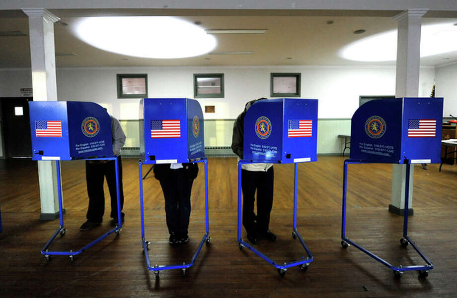 Early morning voting is underway at Bishop Molloy Recreational Center on Tuesday, Nov. 6, 2012, in Point Lookout , N.Y., one of several voting locations that were created as a result of Superstorm Sandy. (AP Photo/Kathy Kmonicek) / FR170189 AP