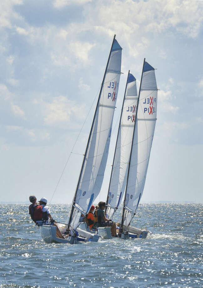 Hour Photo/Alex von Kleydorff. Pixel sailboats compete during the Junior Sailing Association's Pixel Championships at Norwalk Yacht Club