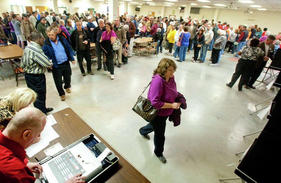 Voters wait in line for over an hour to vote at the Moose Lodge polling site in Campbell County on Tuesday, Nov. 6, 2012, in Lynchburg, Va. (AP Photo/News & Daily Advance, Jill Nance) / News & Daily Advance