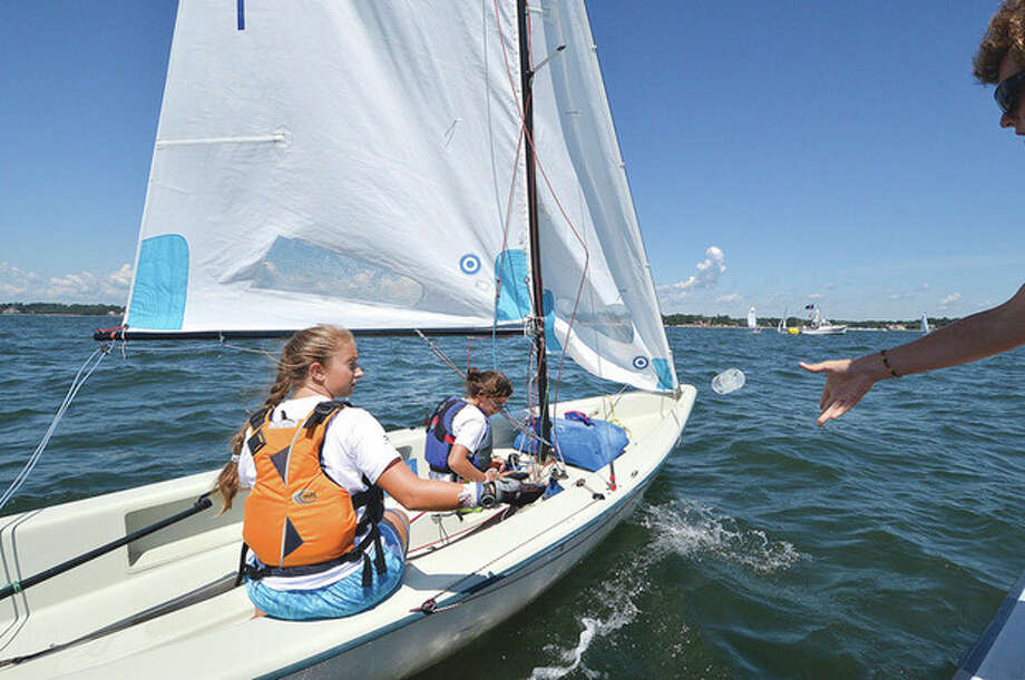 Hour Photo/Alex von Kleydorff. A few bottles of water for the Norwalk Yacht Club competitors