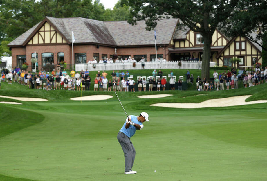Tiger Woods hits to the 18th green during a practice round for the PGA Championship golf tournament at Oak Hill Country Club, Tuesday, Aug. 6, 2013, in Pittsford, N.Y. (AP Photo/Charlie Neibergall) / AP