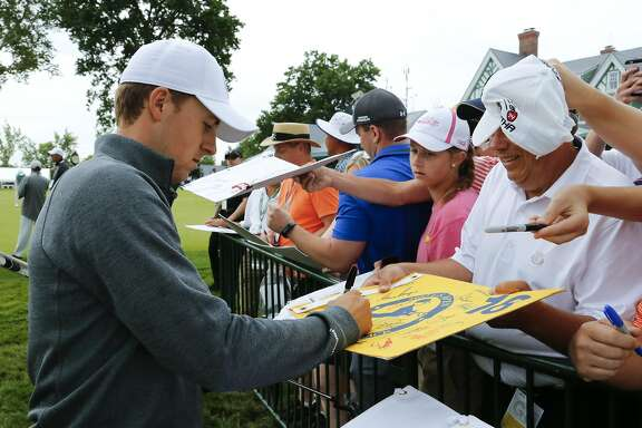 Jordan Spieth signs autographs before a practice round for the U.S. Open golf championship at Oakmont Country Club on Wednesday, June 15, 2016, in Oakmont, Pa. (AP Photo/Gene J. Puskar)