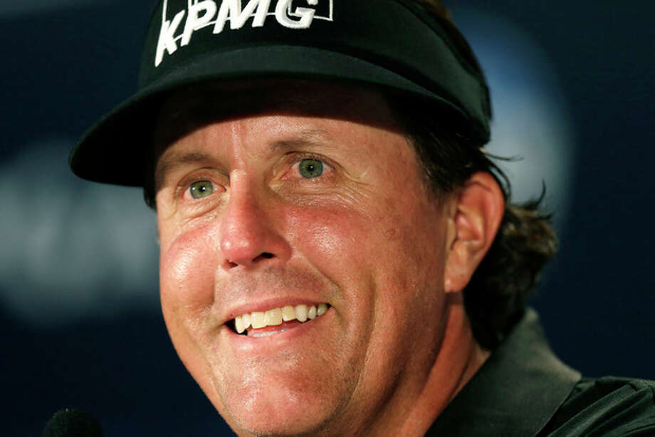 Phil Mickelson speaks at a press conference at the PGA Championship golf tournament at Oak Hill Country Club, Tuesday, Aug. 6, 2013, in Pittsford, N.Y. (AP Photo/Charlie Neibergall) / AP