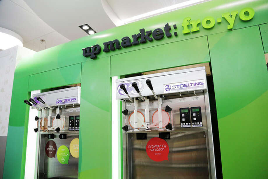 This Wednesday, May 15, 2013, photo, shows frozen yogurt machines at the Walgreens flagship store in the Empire State Building, in New York .The nation's major drugstore chains are opening more in-store clinics in response to the massive U.S. health care overhaul, which is expected to add about 25 million newly insured people who will need medical care and prescriptions, as well as offering more services as a way to boost revenue in the face of competition from stores like Safeway and Wal-Mart. (AP Photo/Mark Lennihan) / AP