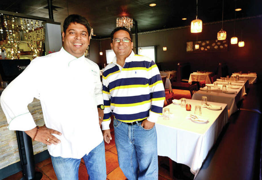 Kausik Roy and Anjum Naveed, owners of Aladin Indian Bistro, have opened their new restaurant on CT Ave.Hour photo / Erik Trautmann / (C)2013, The Hour Newspapers, all rights reserved