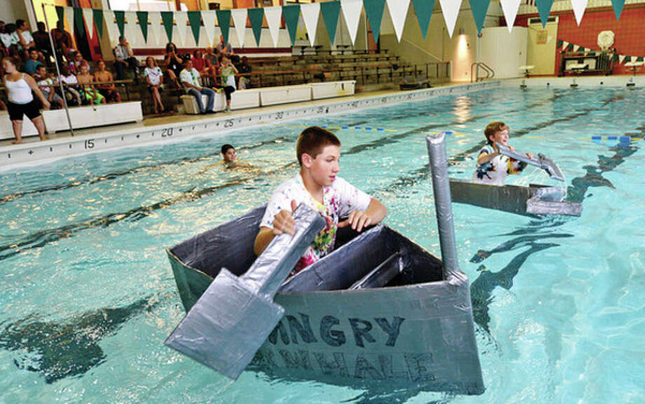 Incoming freshman Quinn Sandor races Julian Collot to the finish as Norwalk High School finishes up its Freshman Academy with a carboard and duct tape boat race in the Norwalk High swimming pool Friday.Hour photo / Erik Trautmann / (C)2013, The Hour Newspapers, all rights reserved