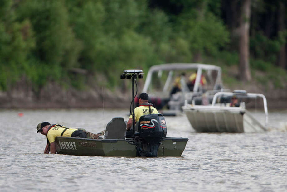Rescue personnel in a boat use an underwater device in the Red River in between East Grand Forks, Minn. and Grand Forks, N.D. on Thursday afternoon, Aug. 8, 2013 to search for 11-year-old Anthony Kuznia who went missing from his East Grand Forks home on Wednesday afternoon. The body of the autistic boy was found Thursday in the Red River. The phenomenon goes by various names - wandering, elopement, bolting - and about half of autistic children are prone to it, according to research published in 2012 in the journal Pediatrics. (AP Photo/The Grand Forks Herald, Jenna Watson) / The Grand Forks Herald
