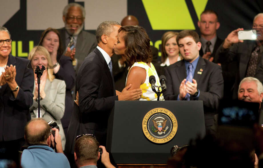 First Lady Michelle Obama introduces her husband President Barack Obama before his address to injured veterans and guests at the Disabled American Veterans National Convention in Orlando, Fla., Saturday, Aug.10, 2013. (AP Photo/Julie Fletcher) / FR170193 AP