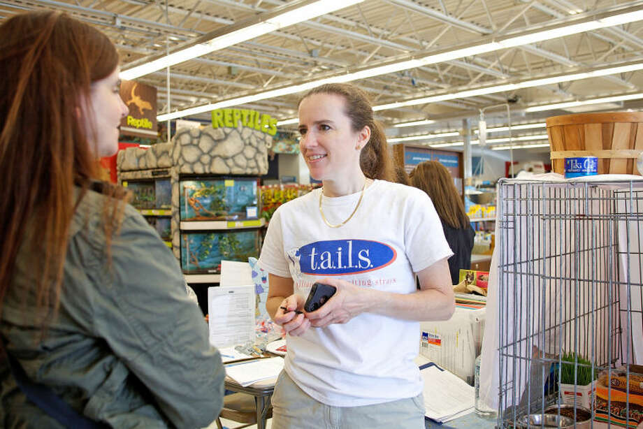 Dorrie Harris talks to potential adopters during a T.A.I.L.S Kitten Kaboodle adoption event at Petco in Norwalk Sunday afternoon. Hour Photo / Danielle Calloway