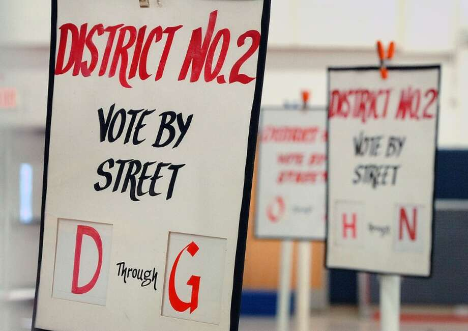 Hour Photo Alex von Kleydorff; Signs direct people to vote by street at District 2 in Wilton